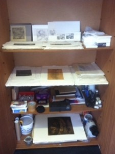 Well stock cupboard with materials and prints